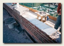 New parapet was constructed at a lower height.