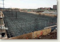 Counterfort earth retaining structures and concrete mat foundations